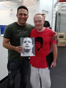 International BJJ legend Renzo Gracie holding the portrait I drew of his late brother Ryan during one of my trips to NY to train at his academy
